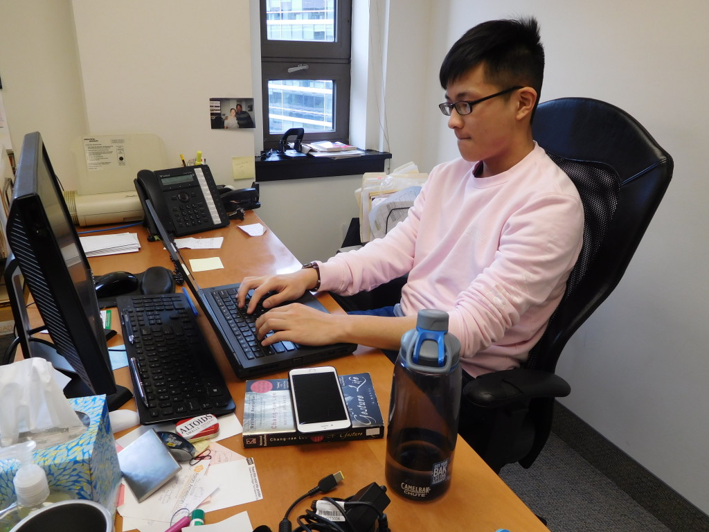 Yuanlong has taken to sitting at Raj's desk on Mondays