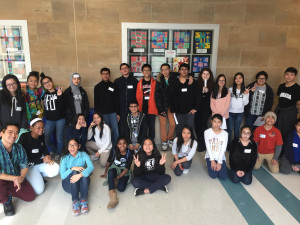 Middle and high school youth pose for a photo together after completing the guided tour.